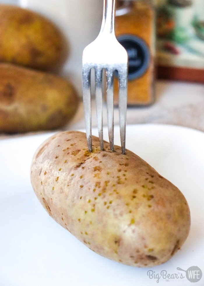 Poking holes in Russet Baking Potato with a fork
