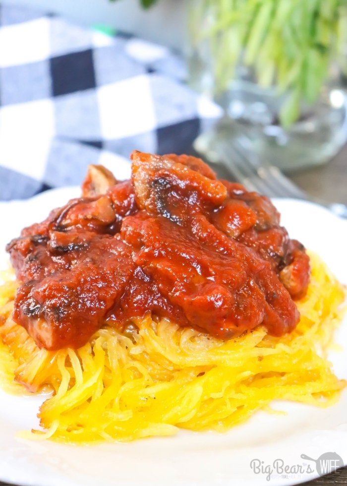 Spaghetti Squash on white plate with red pasta sauce