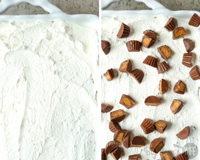 adding frosting and chopped mini peanut butter cups to poke cake