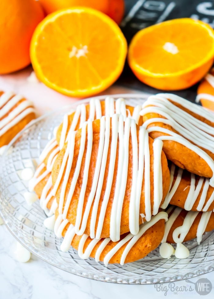 Orange Creamsicle Cookies stacked on clear plate