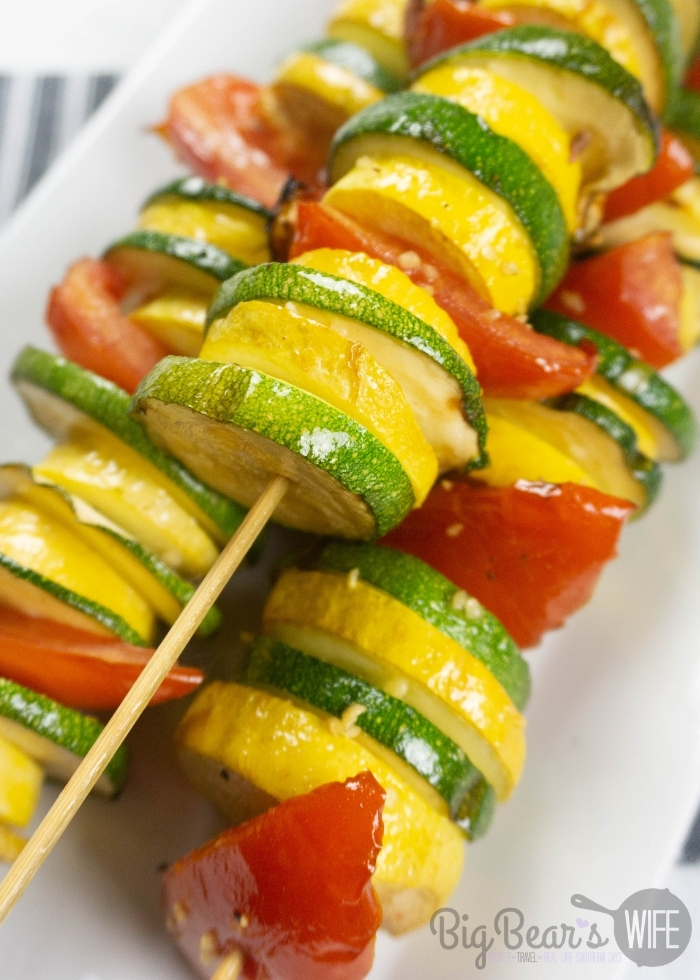 GARLIC BUTTER GRILLED VEGETABLE SKEWERS on white plate with striped napkin