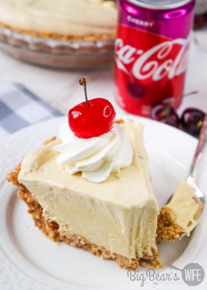 Bite missing from Slice of Cherry Coke Float Pie on White plate