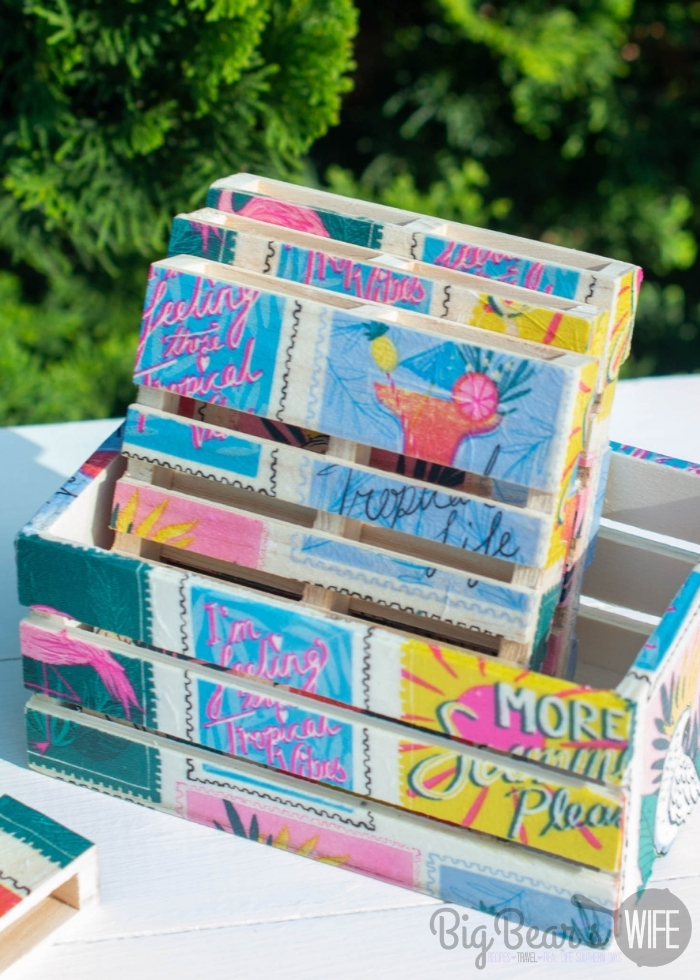 These adorable DIY Mini Pallet Coasters are perfect for summer and super cute for the patio or beside the pool! They're made using napkins, mod podge and mini wooden pallets from Dollar Tree! This step by step photo tutorial will show you exactly how to make them!