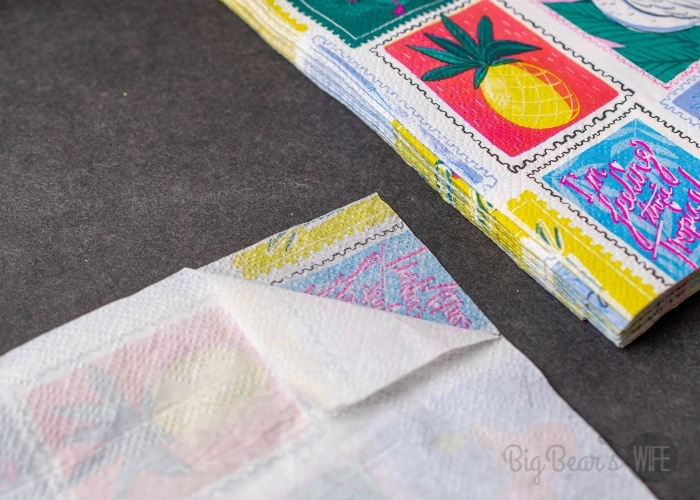 Start off by opening and separating the white backing from the napkins. Discard the white backing.