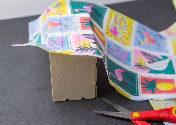 Apply a layer of Mod Podge to one side of the crate that has slats. Gently press the napkin evenly onto the crate, design face up.