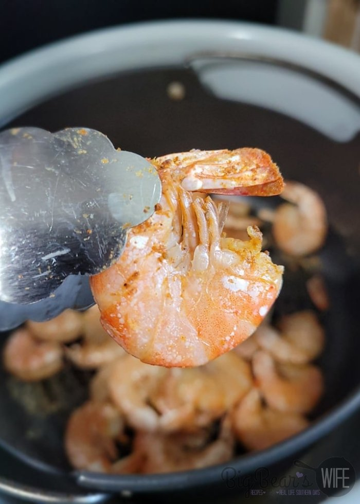 Cooked Shrimp with tongs