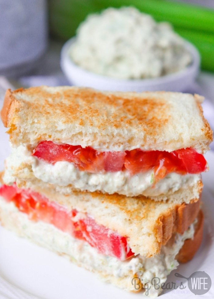 SOUTHERN CHICKEN SALAD SANDWICH  with tomato on a white plate