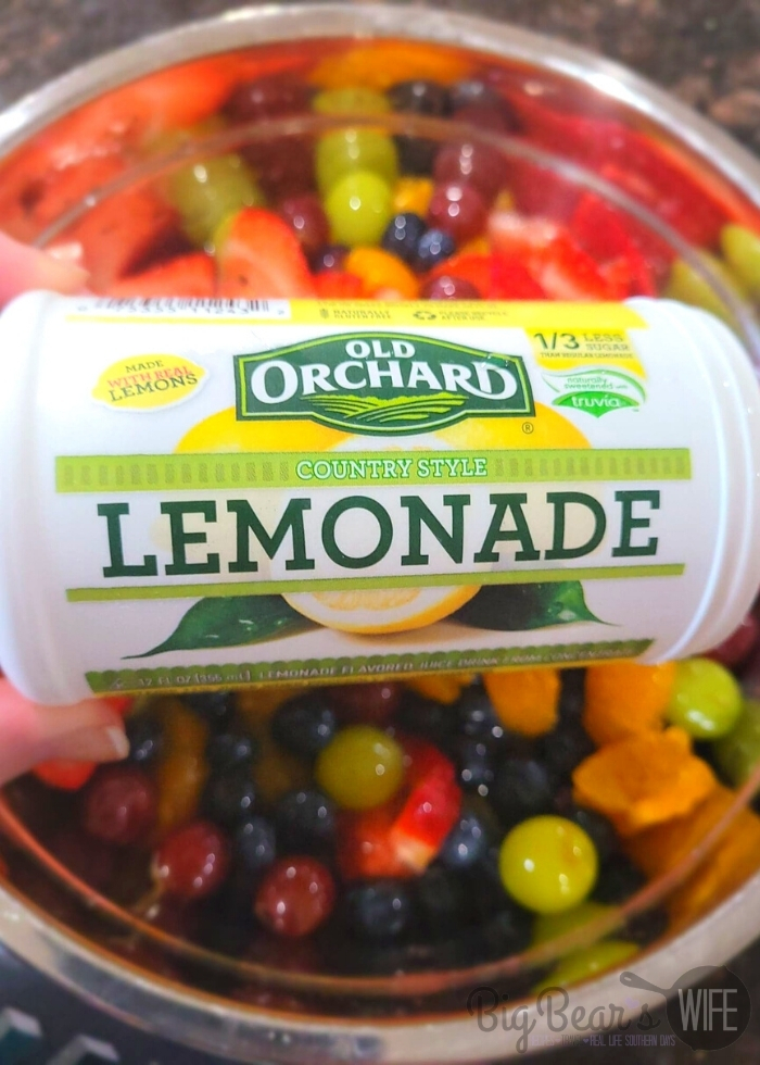 lemonade concentrate over mixed fruit in bowl