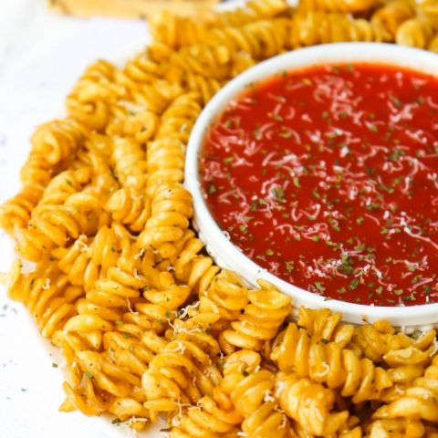 Crispy Air Fryer Pasta Chips with pasta sauce for dipping