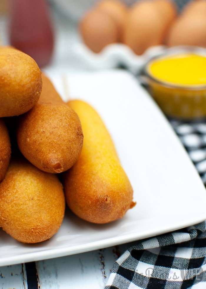 Fallen in love with Disneyland Corn Dogs? Wishing you would make it to Disneyland for the famous corn dogs? Make them at home with this great recipe for Disneyland Copycat Corn Dogs!