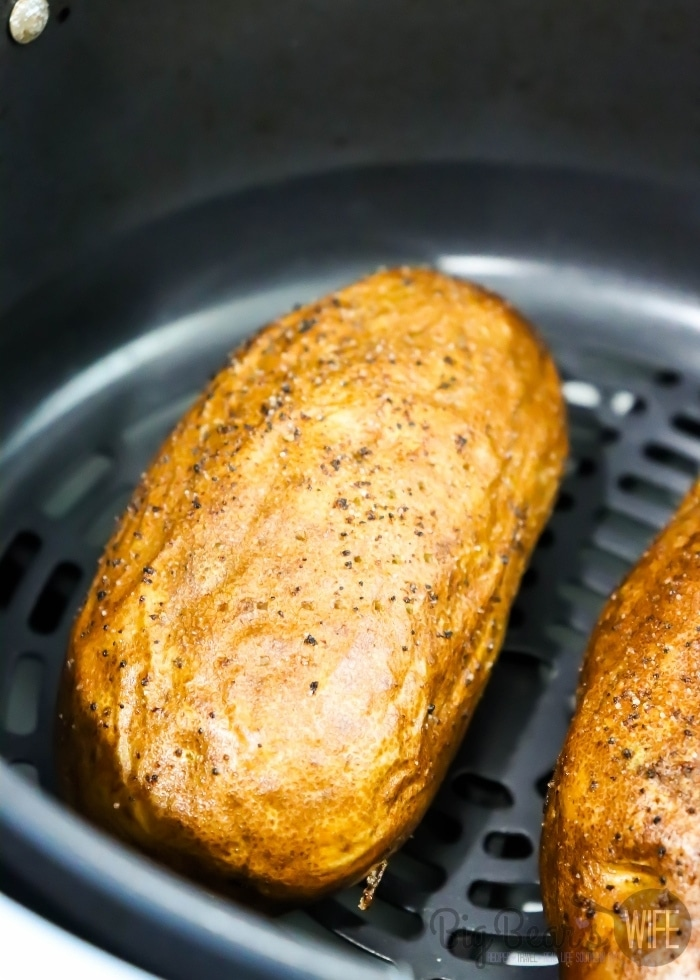 cooked potato in the air fryer basket
