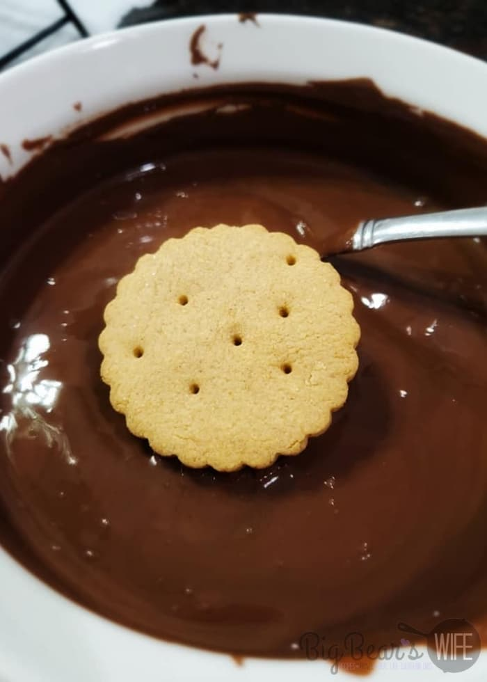dipping cookie into chocolate