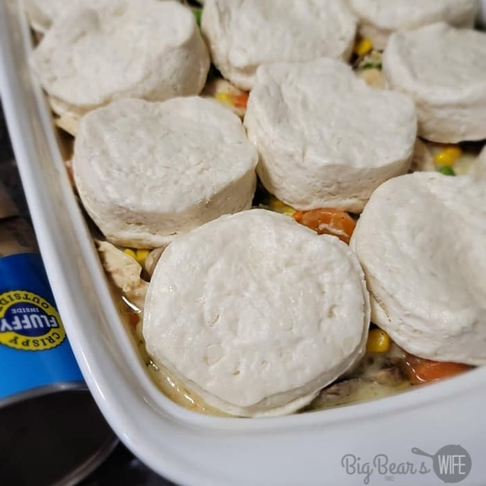 Filling for Pot Pie in a casserole dish topped with raw biscuits