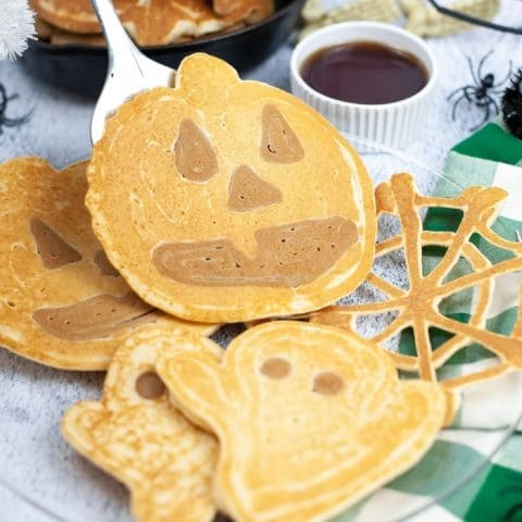 A Halloween breakfast that is perfect for any spooky Monster! These Halloween Pancakes are shaped like ghosts, pumpkins and spiderwebs!