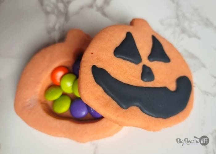 Orange pumpkin cookies filled with candy and topped