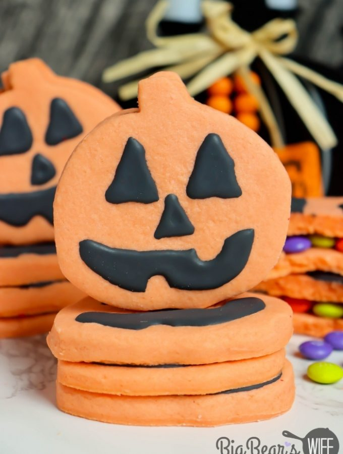 Pumpkin Piñata Cookies - homemade orange sugar cookies stacked together, decorated like Jack-O-Lanterns and filled with Halloween candy!