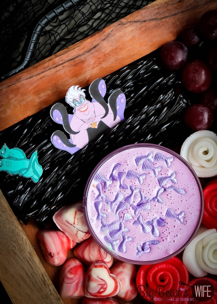 Ursula with black Twizzlers and mermaid dip